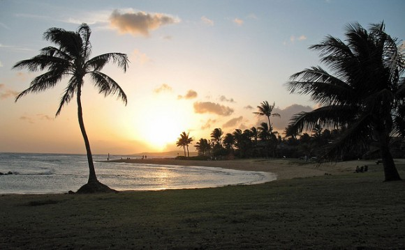 Poipu Beach at sunset by Flickr user skyler miller (creative commons)